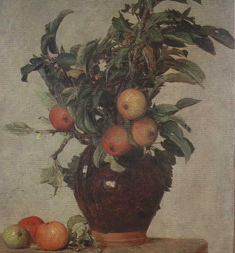 Branches de pommier dans un pichet; pommes a terre